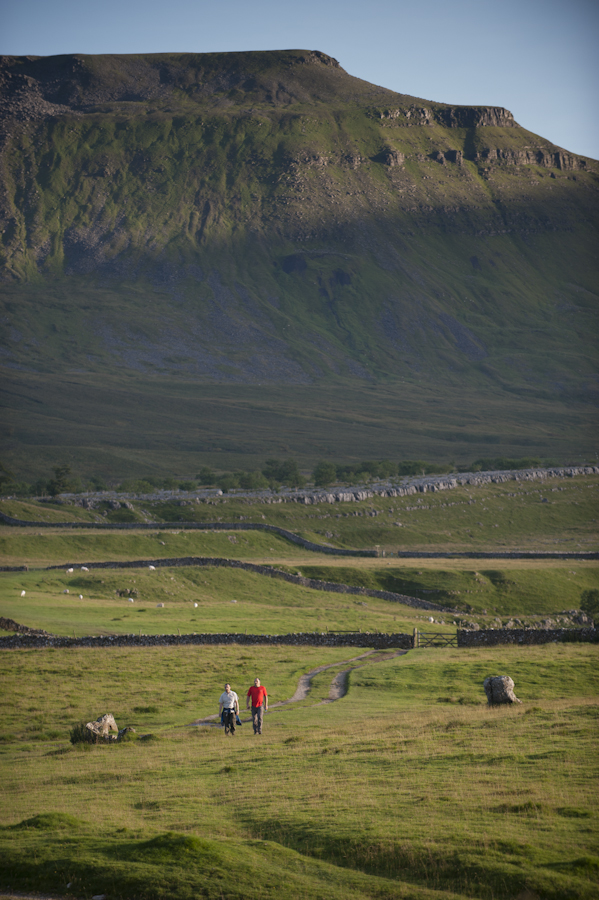 Visitors walking near Ingleborough, Yorkshire Dales National Park