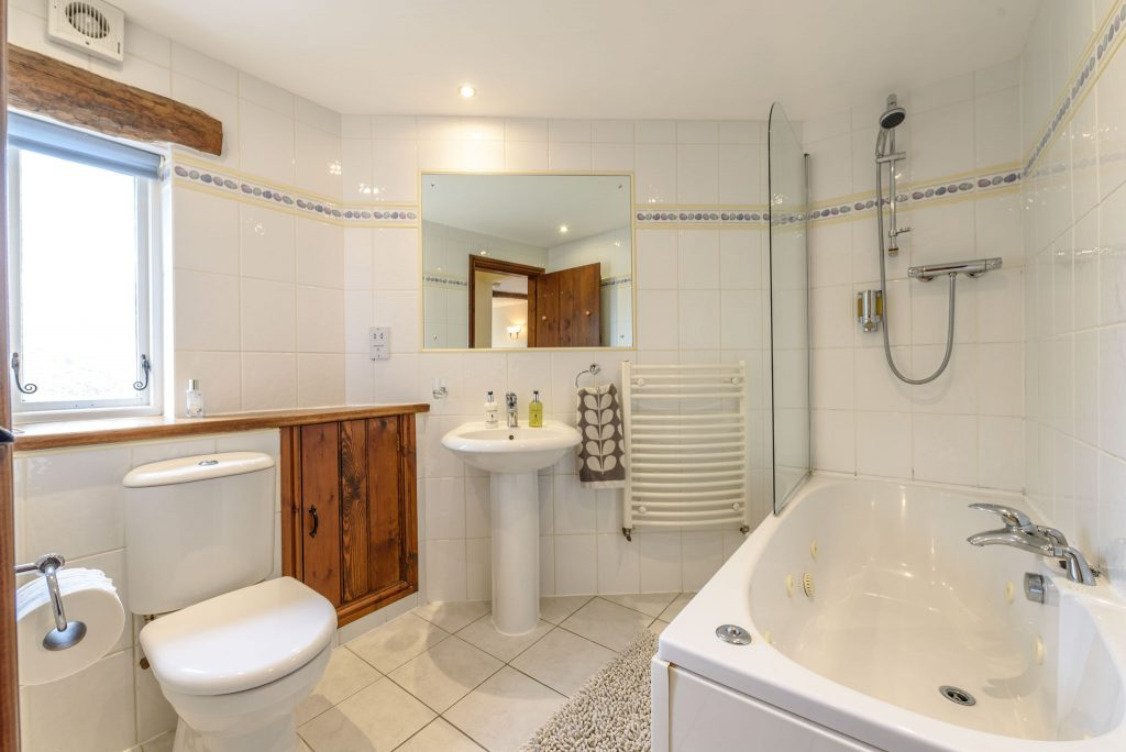 Ground floor bathroom with whirlpool bath and shower