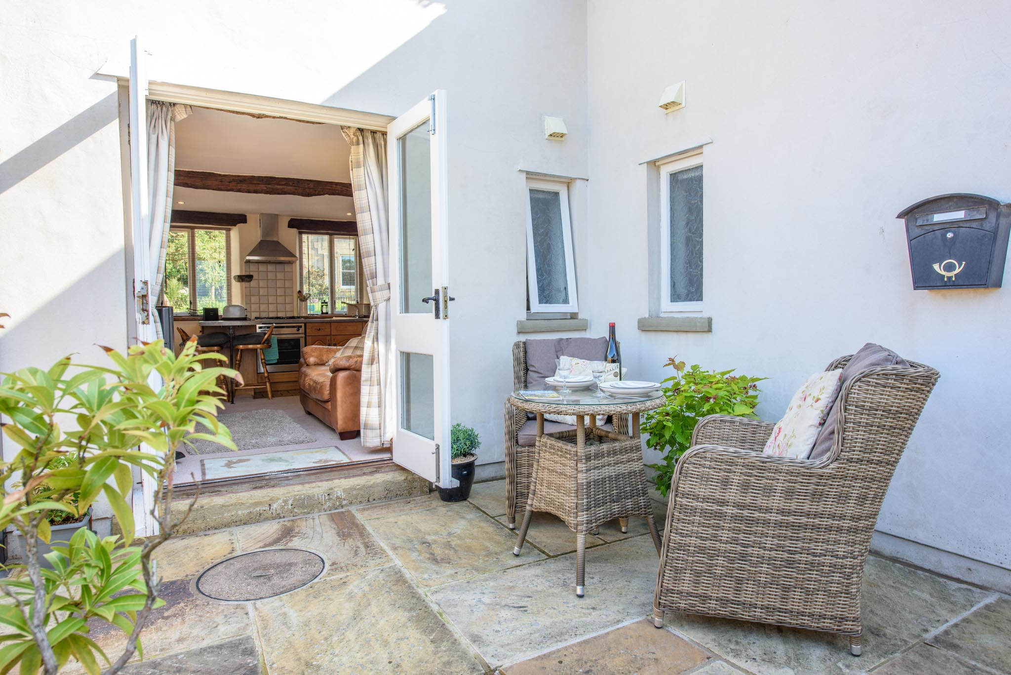 Rear patio with comfortable seating